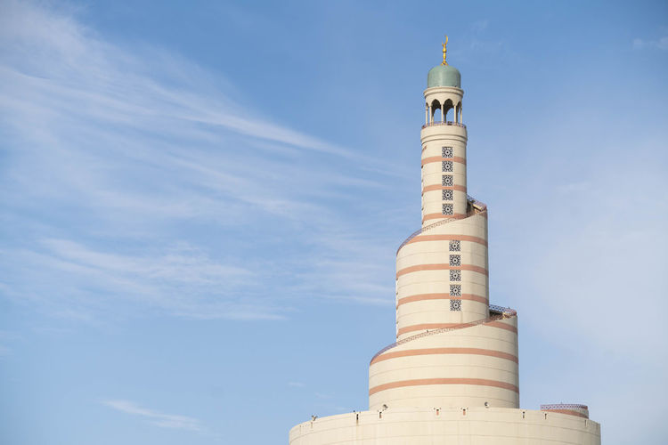 Traditional Arab Architectural Tower in Capital City of Qatar Built Structure Building Exterior Architecture Sky Tower Low Angle View Building No People Tall - High Day Nature Travel Guidance Tourism Outdoors Lighthouse Cloud - Sky Travel Destinations City Sunlight Spire  Ijas Muhammed Photography Doha Qatar Fanar Architecture Arabic Middle East