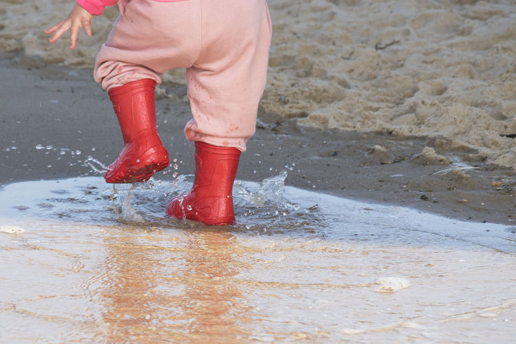 Boots Gumboots Kinda Day Rain Rainboots Splashing Water Wellington Boots Baby ❤ Body Part Human Body Part Human Leg Kid Lifestyles Motion Nature Outdoors Puddle Real People Red Color Rubber Water Waterfront