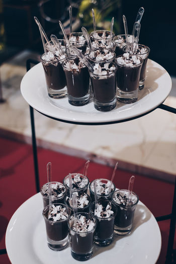 two layer of chocolate mousse in drinking glasses Food And Drink Table Glass Food Drinking Glass No People Refreshment Restaurant Focus On Foreground Close-up Serving Size Still Life Indoors  Business Plate Ready-to-eat Glass - Material Tray Temptation Dessert Backgrounds Portrait Chocolate Mousse Party 2018 In One Photograph Moments Of Happiness