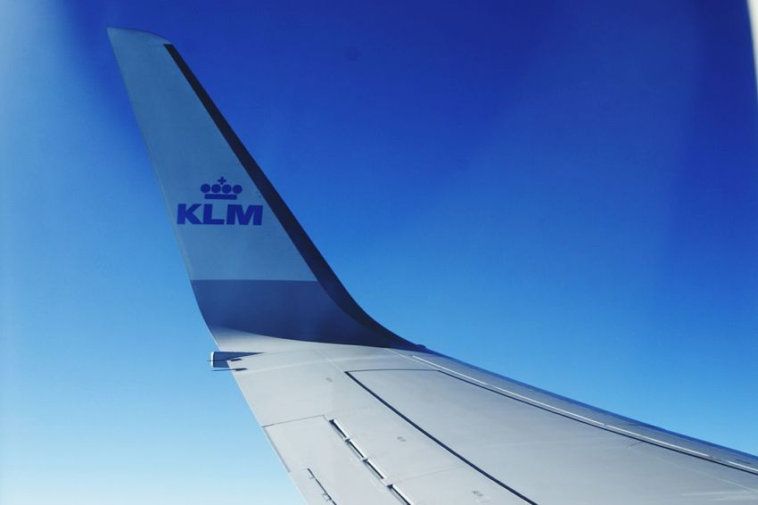 Your Amsterdam KLM Window View From An Airplane Window Blue Sky Airplaneview Airplane Wing Shades Of Blue Clear Sky Let's Go. Together.