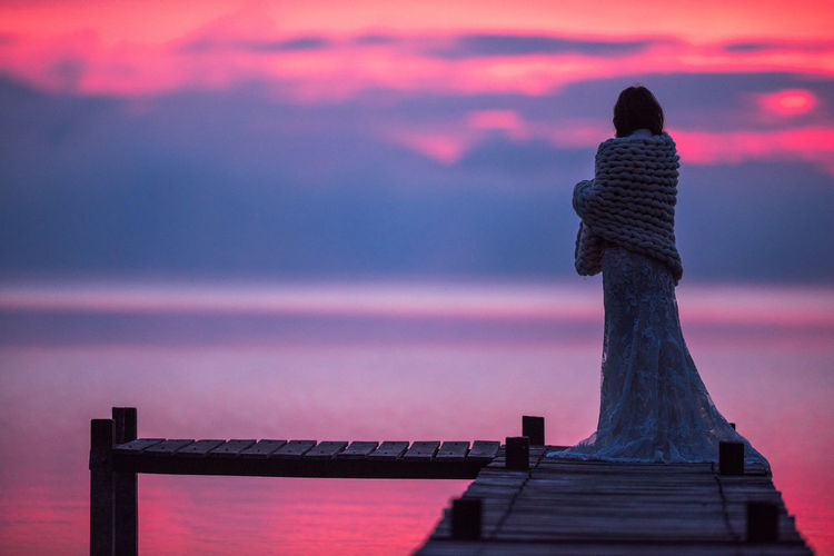 Architecture Art And Craft Beauty In Nature Built Structure Cloud - Sky Craft Dusk Human Representation Looking At View Nature One Person Purple Railing Rear View Representation Sculpture Sky Standing Statue Sunset Water