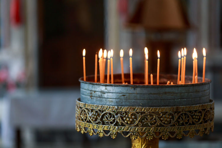 Close-up of glowing candles inside a church Burning Candle Close-up Culture Cultures Fire Flame Glowing Heat - Temperature Illuminated Indoors  Indoors  Lit No People Order Ornate Religion Selective Focus Still Life Stiritual
