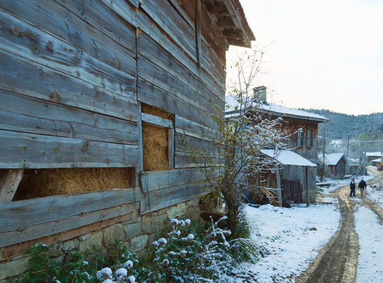 Winter in Bolu Architecture Barn Building Exterior Built Structure Chimneys Day Hay Hay Stack House No People Outdoors Pathway Planks Rotted Wood Sky Sky And Clouds Snow Straw Tiles Tree Village Village Life Water Wheel