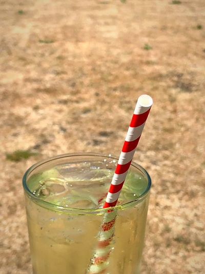 Paper straw and ice cold drink Paper Straw Paper Straws Drink Lime And Soda Lifestyles Refreshment Drink Straw Drinking Straw Food And Drink Glass Drinking Glass Food Focus On Foreground Indoors  Close-up Household Equipment No People High Angle View Freshness Alcohol Glass - Material Fruit Still Life Non-alcoholic Beverage