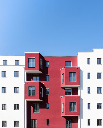 Residential building against blue sky