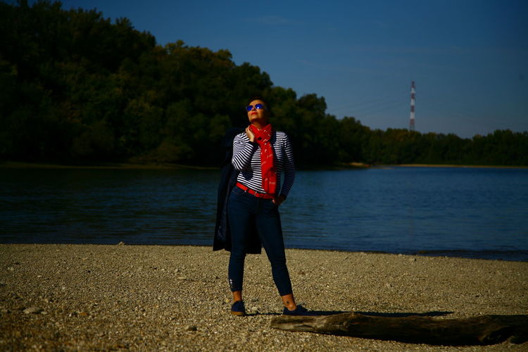 Hungary Girl Red Water Men Standing Lake Flag Pole Flag Stars And Stripes Water's Edge National Icon Symbolism My Best Travel Photo The Modern Professional International Women's Day 2019