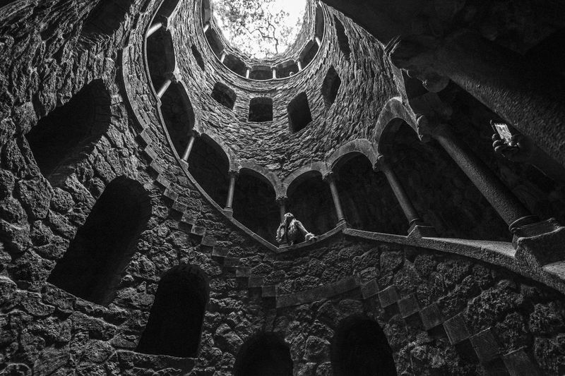 Portugal Quinta Da Regaleira Sintra Spiral Staircase Architectural Column Architecture Blackandwhite Built Structure Low Angle View One Person Stone The Past Tower