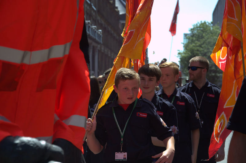 Adult Beard Bearded Boys Celebration Day Firesafety Flag Flags GreaterManchesterFire&Rescue Lifestyles Medium Group Of People Men Outdoors People Real People Red Teenagers  Togetherness Volunteers Volunteers Make A World Of Difference Volunteers? Young Adult