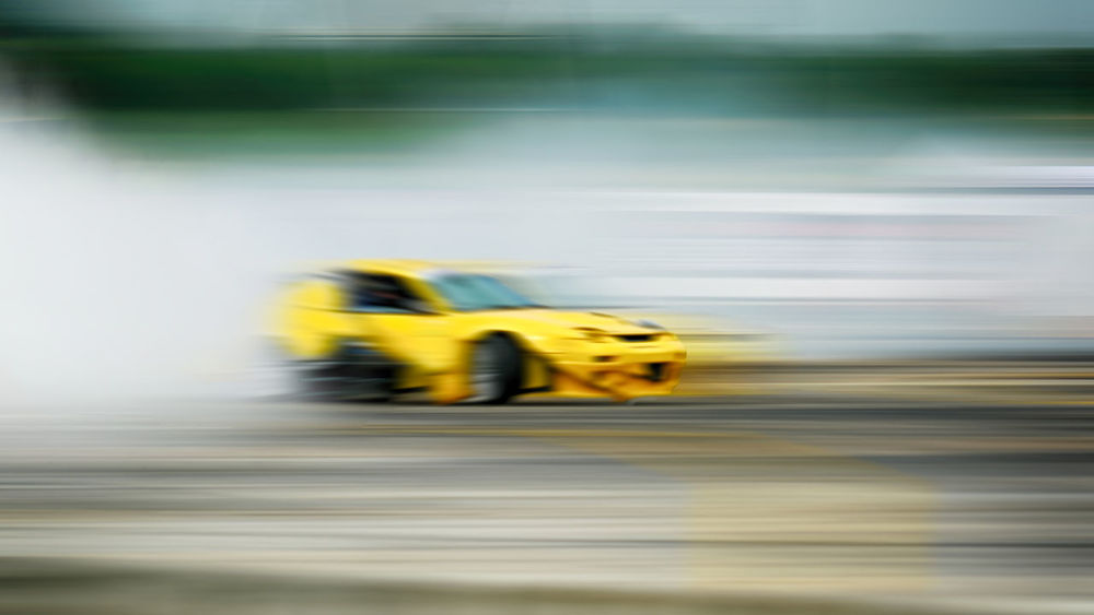 Blurred Car Drift Speed Tracking Transportaion Blurred Motion Car Driftting Land Vehicle Mode Of Transportation Motion Motor Vehicle Nature on the move Road Speed Sport Street Track Transportation Yellow