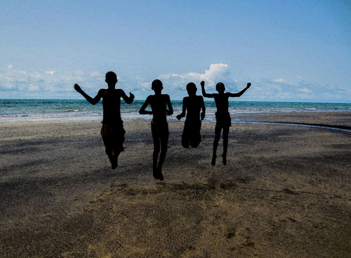 Hapiness by the beach in Gambia Cloud EyeEm Ready   Jump Silhouette Arms Raised Beach Beauty In Nature Day Full Length Gambia  Hapiness Horizon Over Water Leisure Activity Lifestyles Nature Ocean Outdoors Sand Scenics Sea Shiluette Sky Standing Water Waterfront