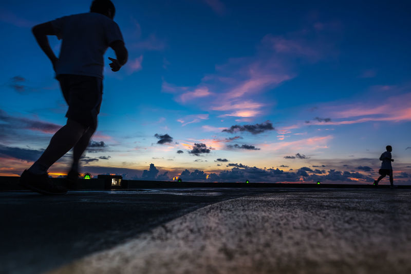 Two men jogging on the oil rig helipad Cloud Dawn Dusk Helipad Jogging Liesure Life Ocean Offshore Offshore Life Offshore Work Offshorelife Oil In Water Oil Rig Running Sea Sea And Sky Sky Sky And Clouds Time Walking Wave