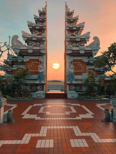 Bali airport Architecture Built Structure Building Exterior Building Sky Sunset The Way Forward Religion Travel Destinations City Outdoors No People Tree Direction Place Of Worship Plant Nature Footpath Belief Street