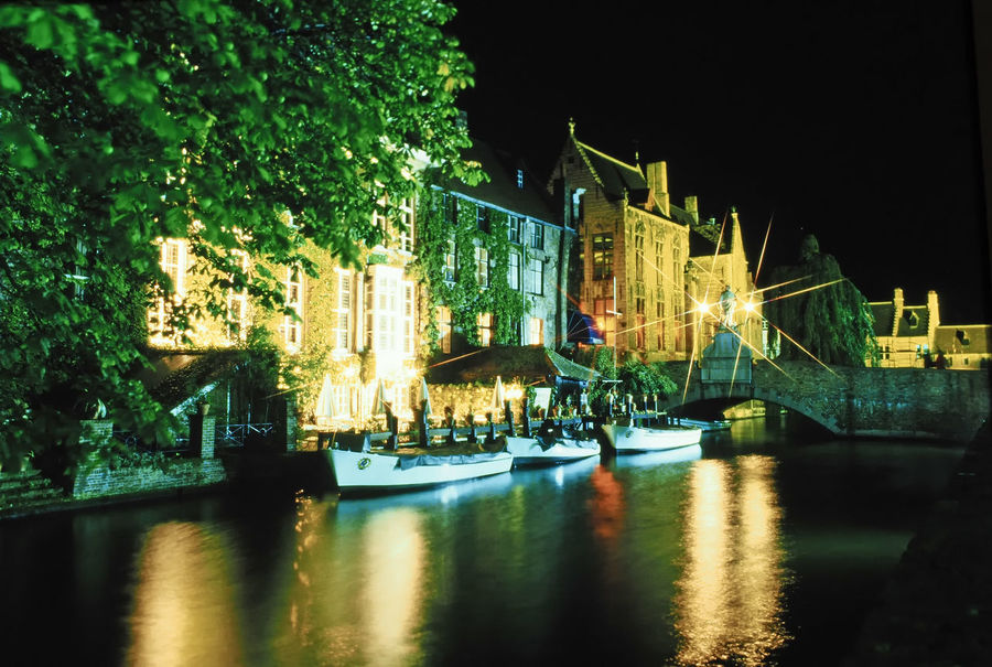 Tourist boats on the Dijver Canal - Brugge, Belgium Architecture Reflection Night Water City Sky Tree Outdoors Illuminated Transportation No People Night Shots  Mode Of Transport Brugge, Belgium Nautical Vessel Building Exterior Built Structure A Taste Of Brugge Brugge Canals HUAWEI Photo Award: After Dark