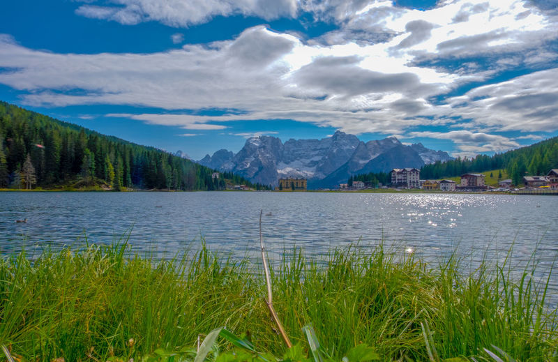 Beauty In Nature Cloud - Sky Day Grass Lake Landscape Mountain Mountain Range Nature No People Outdoors Scenics Sky Tranquil Scene Tranquility Tree Water
