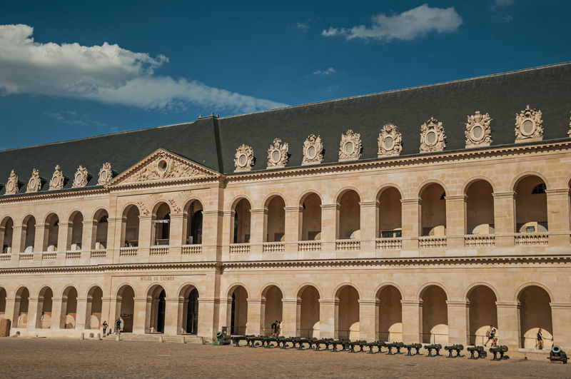Inner courtyard of the les invalides palace with old cannons in paris. the famous capital of france.