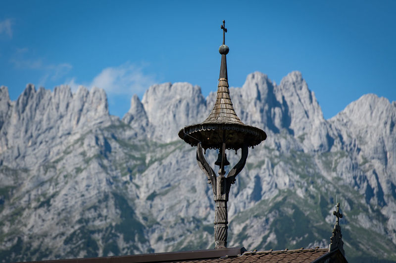 Bell tower Mountain Day Architecture Religion Scenics - Nature Nature Built Structure Belief Sky No People Cold Temperature Travel Destinations Spirituality Place Of Worship Beauty In Nature Tranquil Scene Mountain Range Tower Tranquility Building Outdoors Spire  Snowcapped Mountain Mountain Peak