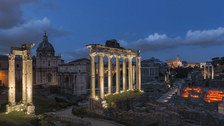 Roman forum in city at dusk