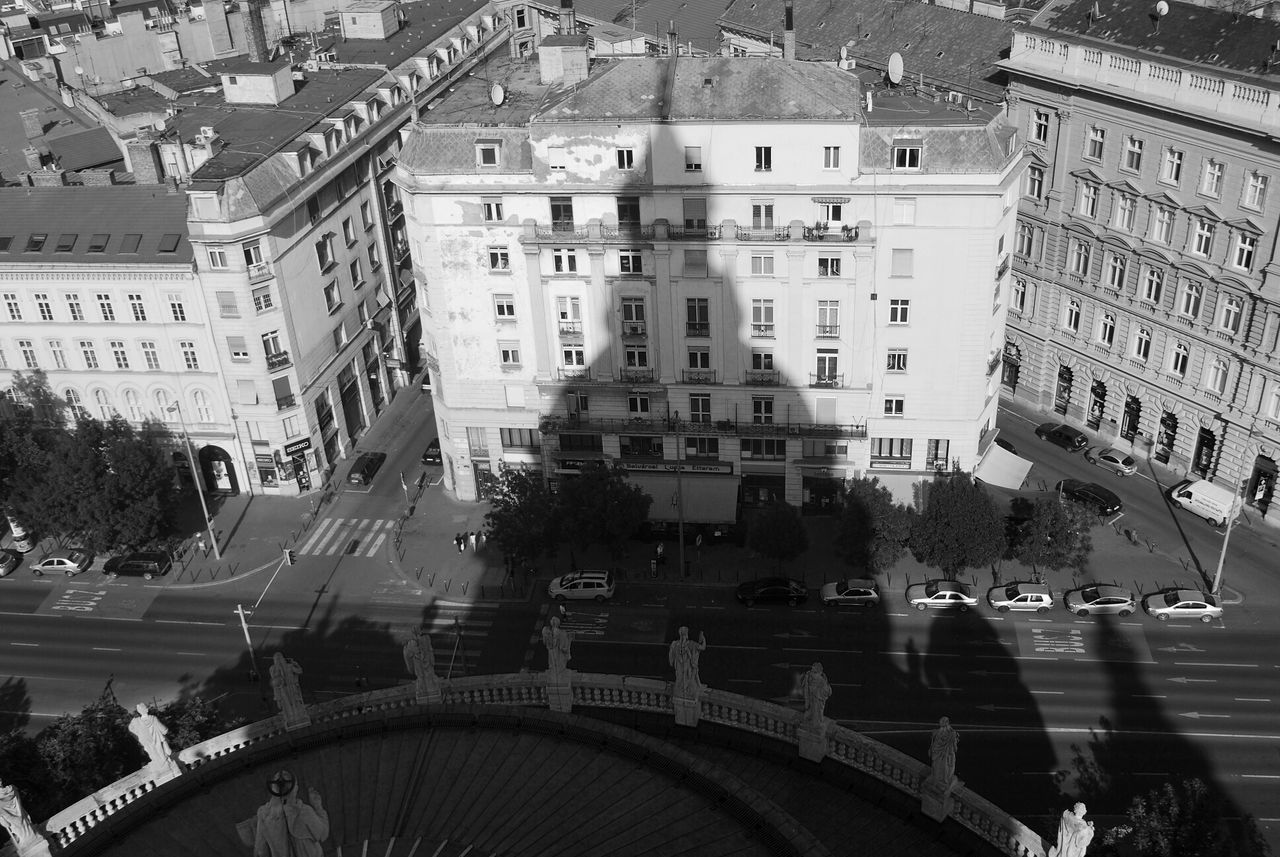 High angle view of buildings and street in city with shadow