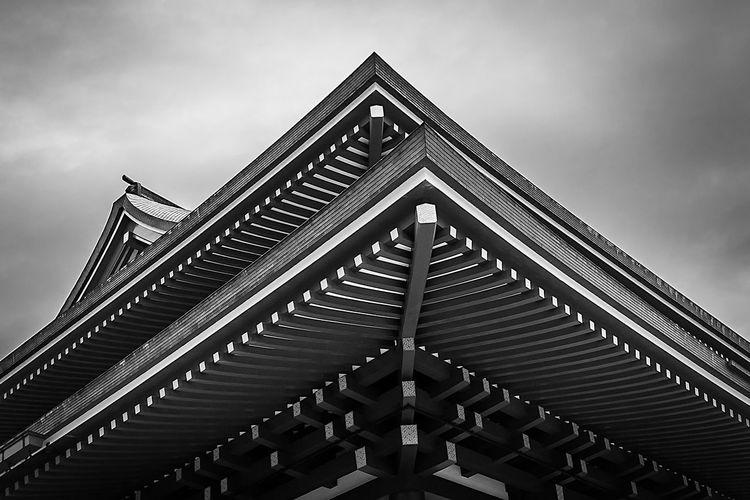 Detail shot of roof at naritasan shinshoji temple against sky