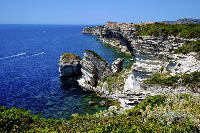 City of Bonofacio and southern steep coast of Corsica Architecture Bonifacio Clear Blue Sky Cliff Cliffs Corsica Europe Island Landscape Mediterranean Sea Medival City Motorboats No People Ocean Old Part Of Town Outdoors Panoramic View Point Of Interest Shore Steep Coast Summerly Water