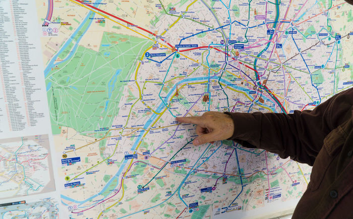 Paris subway map Adult Adults Only Analyzing Day Human Body Part Human Hand Index Finger Indoors  Map Map Men One Man Only One Person Only Men Paris Paris, France  People Searching Subway Watching World Map