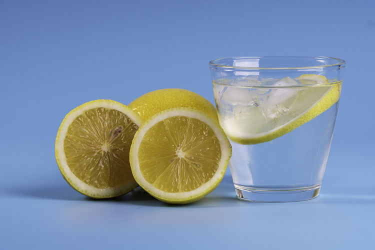 Close-up of drink on glass against white background