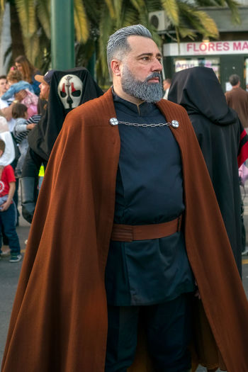 Malaga, Spain - May 05, 2018. Members of the 501st Legion Spanish Garrison dressed as Count Dooku, Sith Lord from the movie saga Star Wars, perform along the walk Muelle Uno, Malaga, Spain Count Dooku Malaga Muelle Uno SPAIN Saga Star Wars Adult Beard Business Clothing Facial Hair Focus On Foreground Front View Group Of People Incidental People Lifestyles Looking Looking Away Males  Mature Men Men People Real People Roberto Sorin Shopping Sith Lord Standing Star Wars Love Starwars Three Quarter Length The Photojournalist - 2018 EyeEm Awards The Street Photographer - 2018 EyeEm Awards