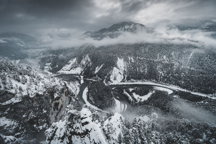 view down to the infamous Rheinschlucht Valley in Flims, Switzerland Outdoors Covering Snowcapped Mountain Environment Cloud - Sky Sky Scenics - Nature Mountain Snow Winter Beauty In Nature Water Cold Temperature Day Rheinschlucht Graubünden Schweiz Schweizer Alpen Switzerland Switzerlandpictures