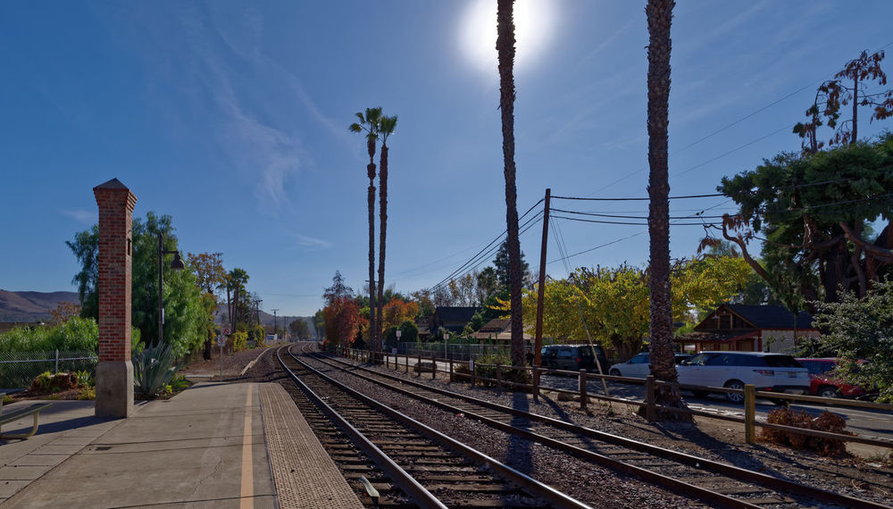 Keep going on. Leading Lines Pentax PENTAX K-1 Pentax 15-30 F/2.8 Wide Angle California Los Ángeles Historic Clear Sky USA Blue Sky Railroad Station Amtrak Palm Architecture Cloud - Sky Day Electricity Pylon No People Outdoors Rail Transportation Railway Track Sky The Way Forward Transportation Tree California Dreamin