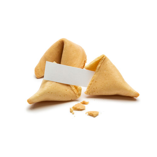 Close-up of fortune cookies against white background
