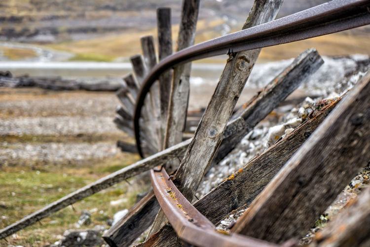Old, twisted railroad track Selective Focus Transportation No People Close-up Day Metal Wheel Focus On Foreground Wood - Material Nature Bicycle Outdoors Rusty Field Land Vehicle Land Mode Of Transportation Obsolete Tire Abandoned Spoke Track Rail Track Railroad Track Spitsbergen Svalbard  Arctic