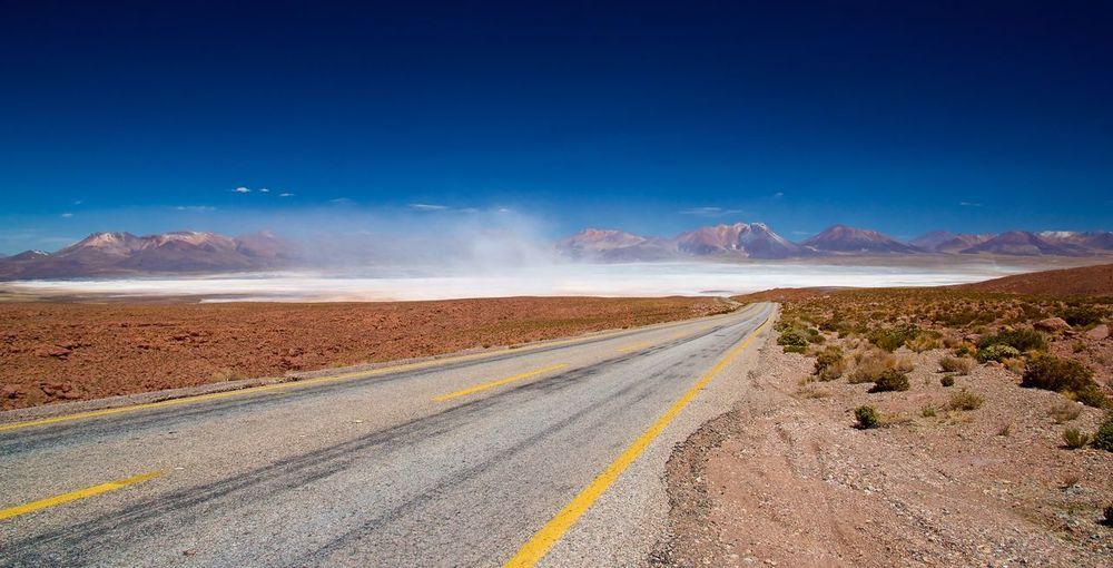Road By Desert Against Sky