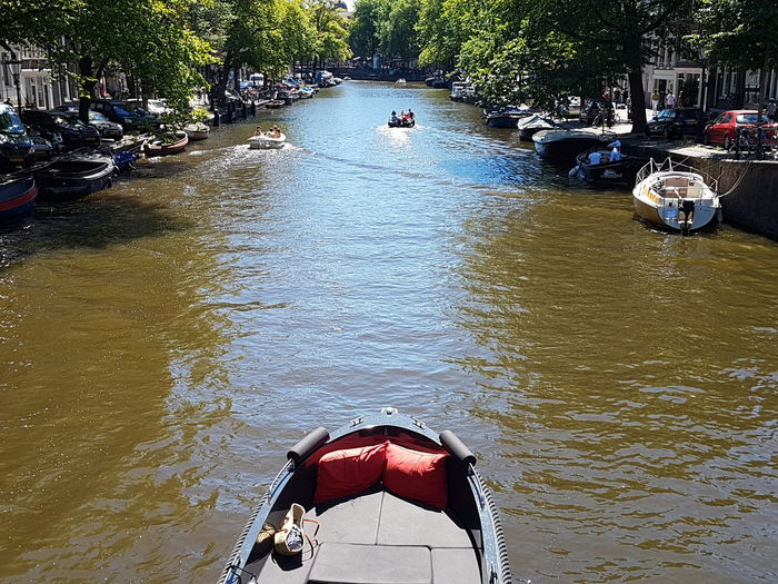 River Canal Canals And Waterways Travel Writing Amsterdam Amsterdamcity Amsterdam Canal Water Nautical Vessel Tree Swimming High Angle View