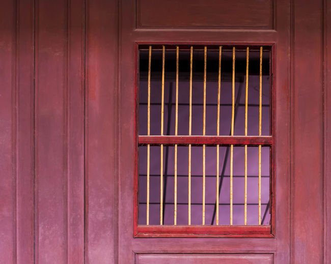 Old window shutters in wooden wall. Architecture Building Building Exterior Built Structure Closed Day Door Entrance Full Frame House Metal No People Outdoors Pattern Protection Safety Security Security Bar Window Window Frame Wood - Material