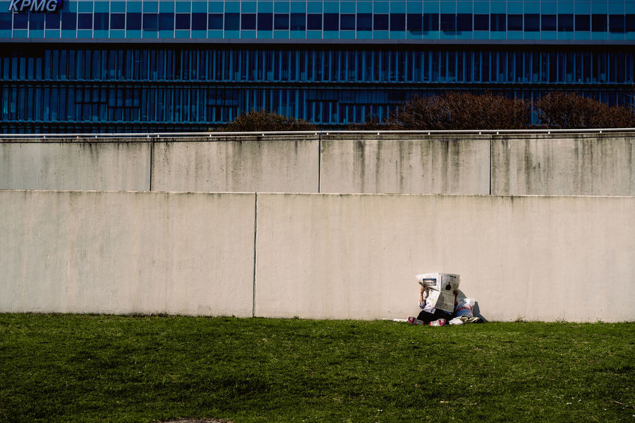 Bauhaus Archives Bauhaus Bauhaus Building Bauhaus Museum Bauhaus Architecture Bauhaus Style Architecture Building Exterior Built Structure City Day Field Full Length Grass Land Nature Outdoors People Plant Real People Sitting Sunlight Togetherness Two People Wall - Building Feature