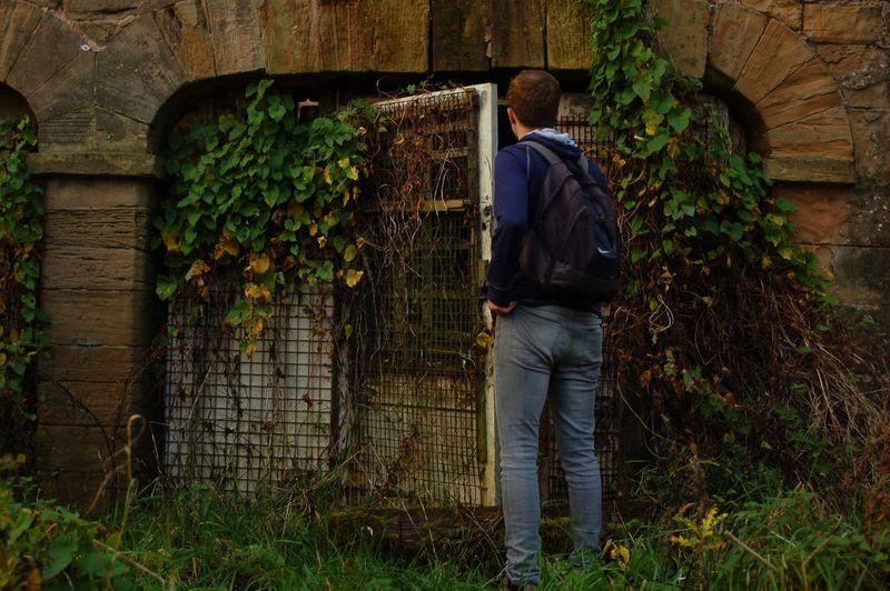 Man Entering Abandoned Building