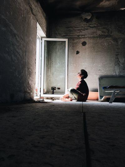 Full length of a man sitting on floor