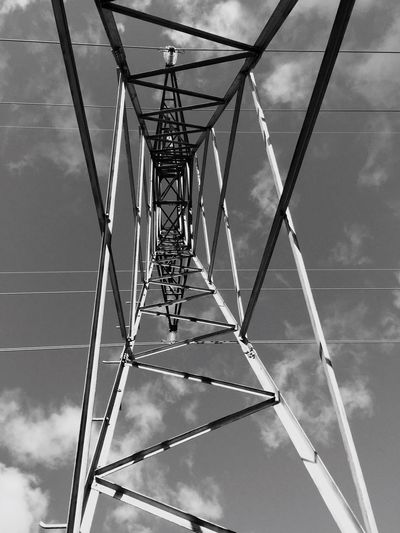 Dramatic Angles Electricity  Low Angle View Sky Connection Day Directly Below Cloud Outdoors Power Line  Cloud - Sky Tall Electricity Tower