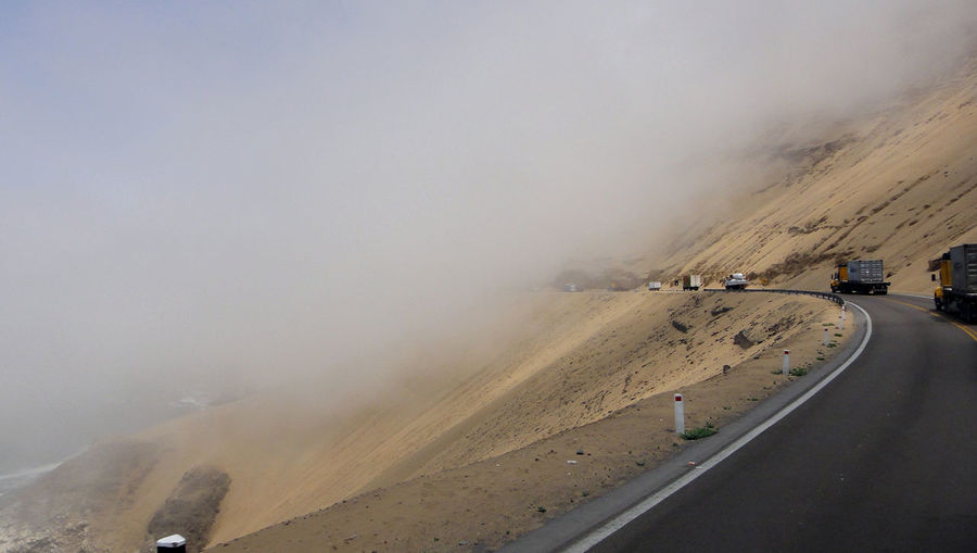 Lima Car Climate Cordillera De Los Andes Environment Fog Geology Land Vehicle Landscape Mode Of Transportation Motion Motor Vehicle Mountain Nature No People Non-urban Scene on the move Pacific Ocean Road Scenics - Nature Smoke - Physical Structure The Way Forward Transportation Travel