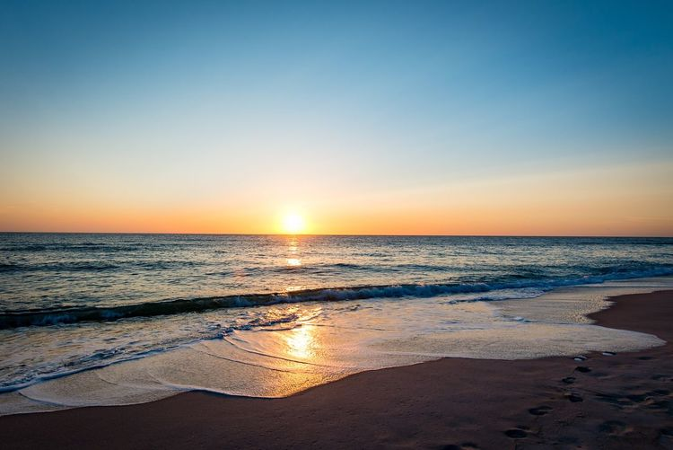 Sea Sunset Scenics Horizon Over Water Beach Beauty In Nature Water Tranquil Scene Nature Tranquility Sand Idyllic Clear Sky Sunlight Wave Sky Outdoors Vacations Travel Destinations No People