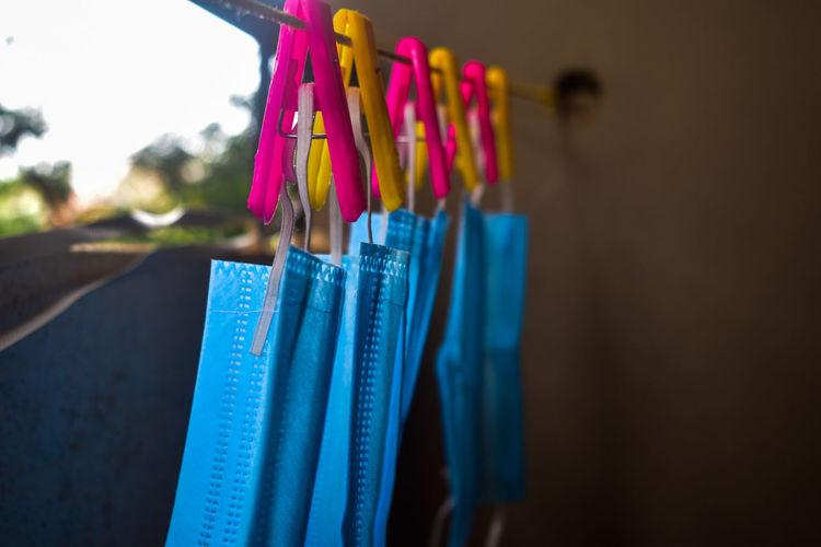 Close-up of face masks hanging on clothesline