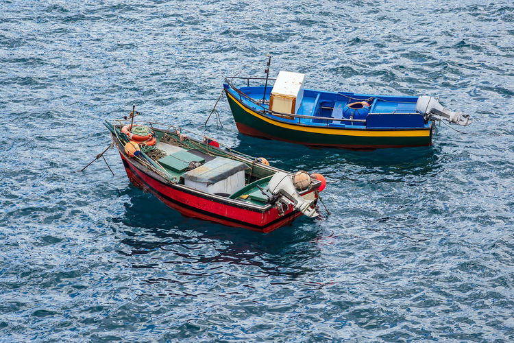 Fishing boats in Camara de Lobos on the island Madeira, Portugal. Nautical Vessel Water Transportation Sea Day High Angle View Nature No People Outdoors Motorboat Beauty In Nature Fishing Boat Boat Fisherman Fishery  Madeira Portugal Camara De Lobos Travel Destinations Travel Tourism Relaxation Vacation