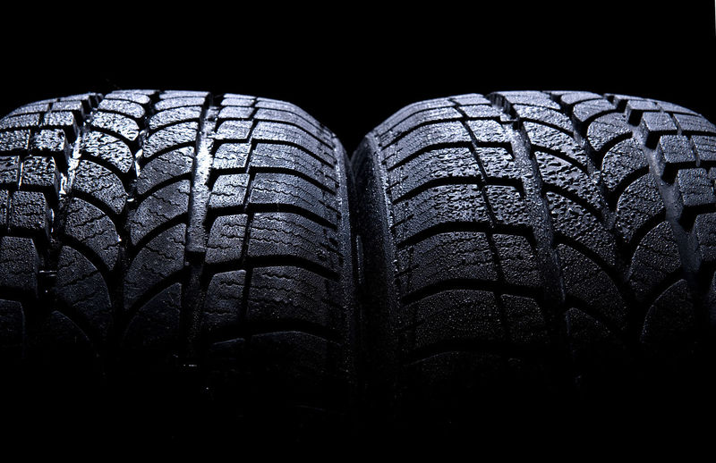 Car tire isolated on black background Automobile New Objects Tires Transport Transportation Wheel Auto Black Car Tire Car Tires Car Tyre Car Tyres Close-up Closeup No People Nobody Rubber Tire Tyre Tyres Unused Vehicle Winter Tires Winter Tyres