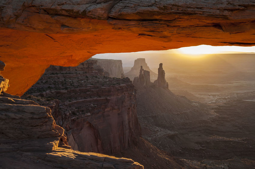 Mesa Arch at Sunrise Mesa Arch, Utah National Park Unique Perspectives United States Arid Climate Beauty In Nature Cave Cliff Day Geology Natural Arch Natural Bridge  Nature No People Outdoors Physical Geography Rock - Object Rock Formation Scenics Sky Sunrise Sunset Tranquil Scene Tranquility Travel Destinations