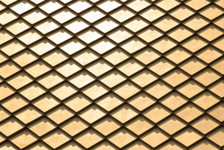 Golden Backgrounds Pattern Full Frame Shape No People Textured  Design Wall - Building Feature Indoors  Geometric Shape Square Shape Architecture Metal Built Structure Repetition Tile Diamond Shaped Flooring Wallpaper Tiled Floor Textured Effect Ceiling Roof