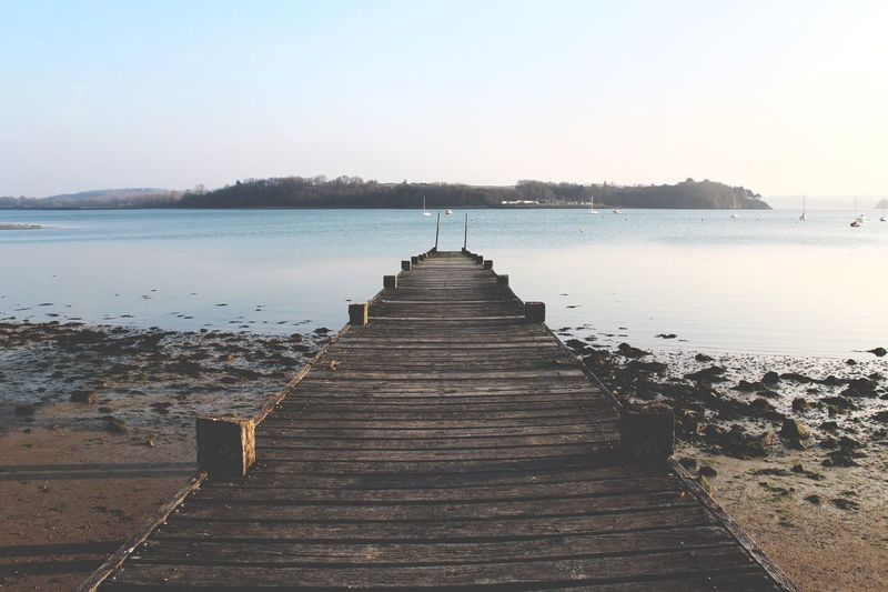 View of jetty leading to the sea