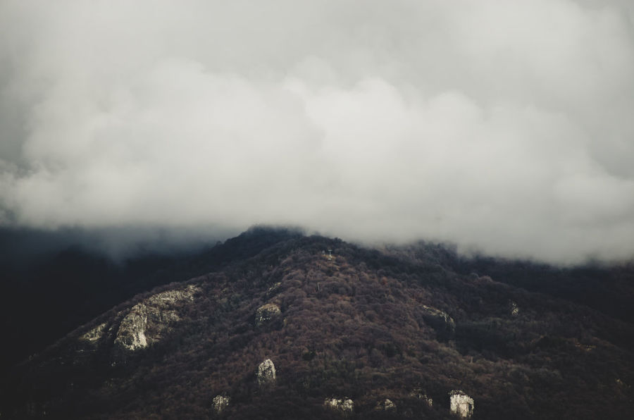 low clouds on foothills Mountain Cloud - Sky Sky Tranquil Scene Environment Scenics - Nature No People Landscape Tranquility Beauty In Nature Non-urban Scene Nature Land Day Outdoors Mountain Range Fog Remote Physical Geography Mountain Peak