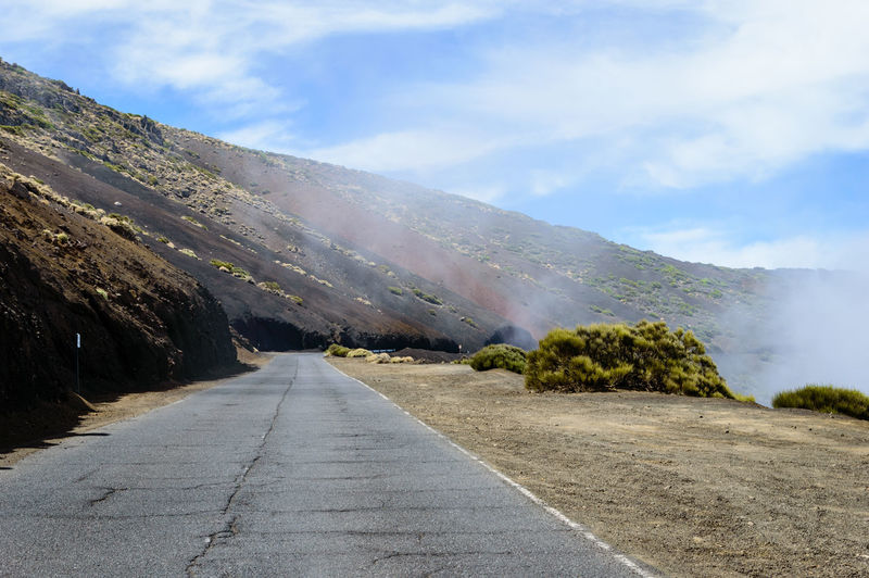 Loney, foggy mountain road under a blue sky (El Teide, Tenerife, Spain) Asphalt El Teide Lonely Nature Road Tranquility Abandoned Adventure Blue Sky Fine Art First Eyeem Photo Fog Foggy Mountain Roadtrip Tenerife Tranquil Scene