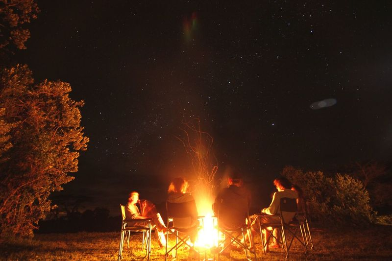 The Camp Fire - Stories and wine Flame Burning Camping Night Bonfire Heat - Temperature Men Nature Outdoors Sky Togetherness People Star - Space Campfire Underthestars Adventure Kenya Safari Canonphotography Long Exposure