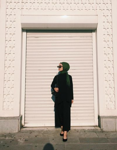 Sunshine Nice Pic City City Life Black Blackandwhite Green Glasses Black Full Length One Person Real People Architecture Standing Building Exterior Rear View Day Lifestyles Clothing Adult Outdoors Closed Shutter Door My Best Travel Photo EyeEmNewHere